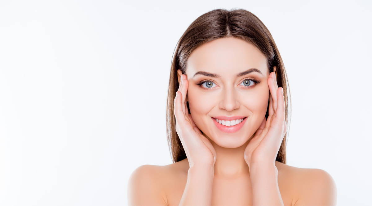 beautiful woman touching sides of face|Is Vegan Collagen As Good As Animal Collagen