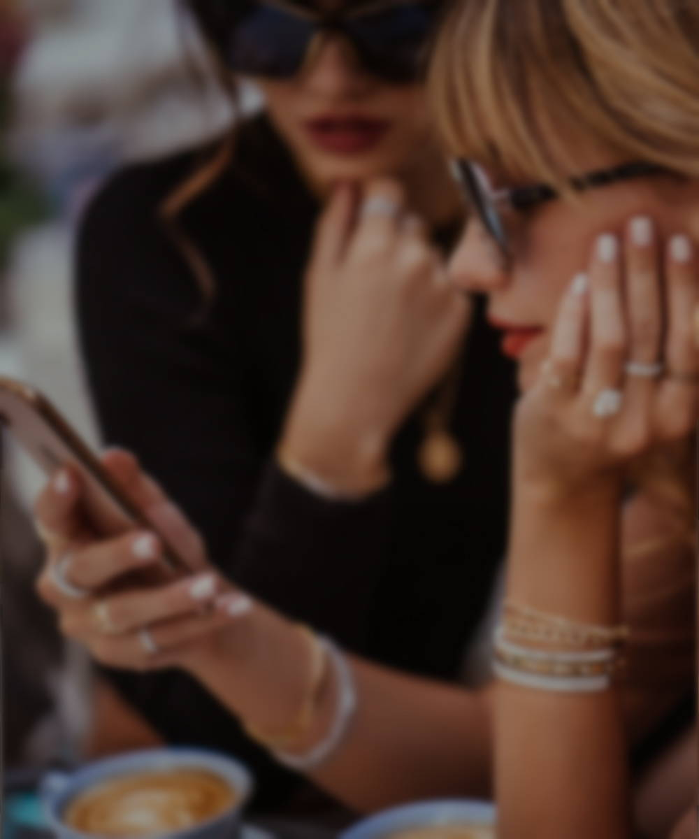 Models on their phone wearing ring Concierge jewelry