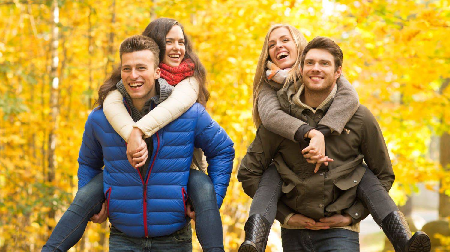 Smiling friends having fun in autumn park | Baby It's Gold Outside! Outdoor Fall Activities To Do To Stay Active This Season | Fall activities | Featured