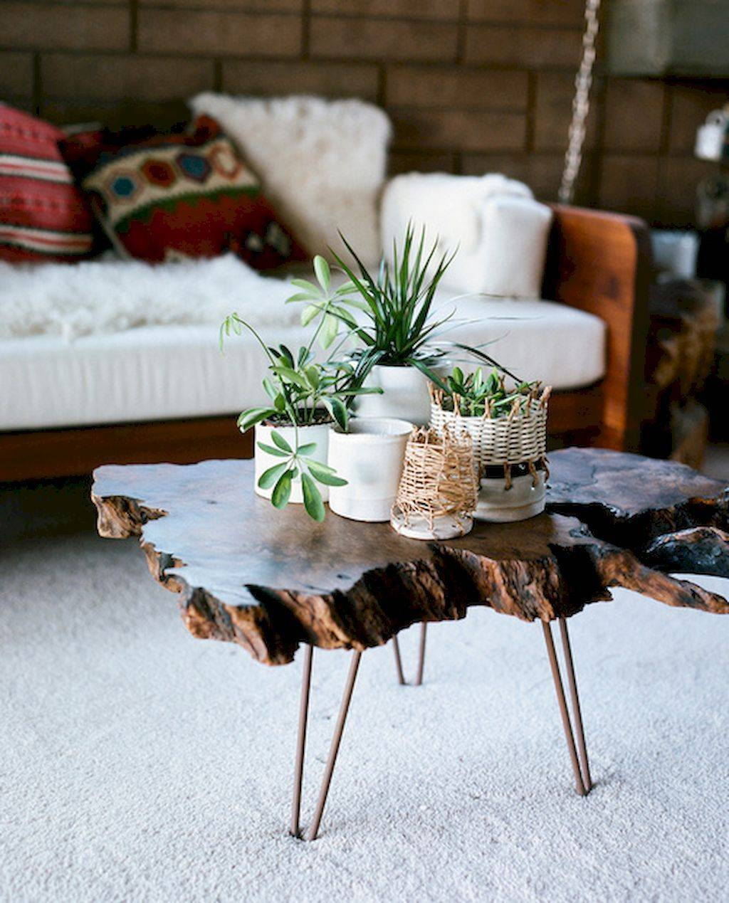 Bring outdoor home decor inside with plants woodwork, and hand crafted materials