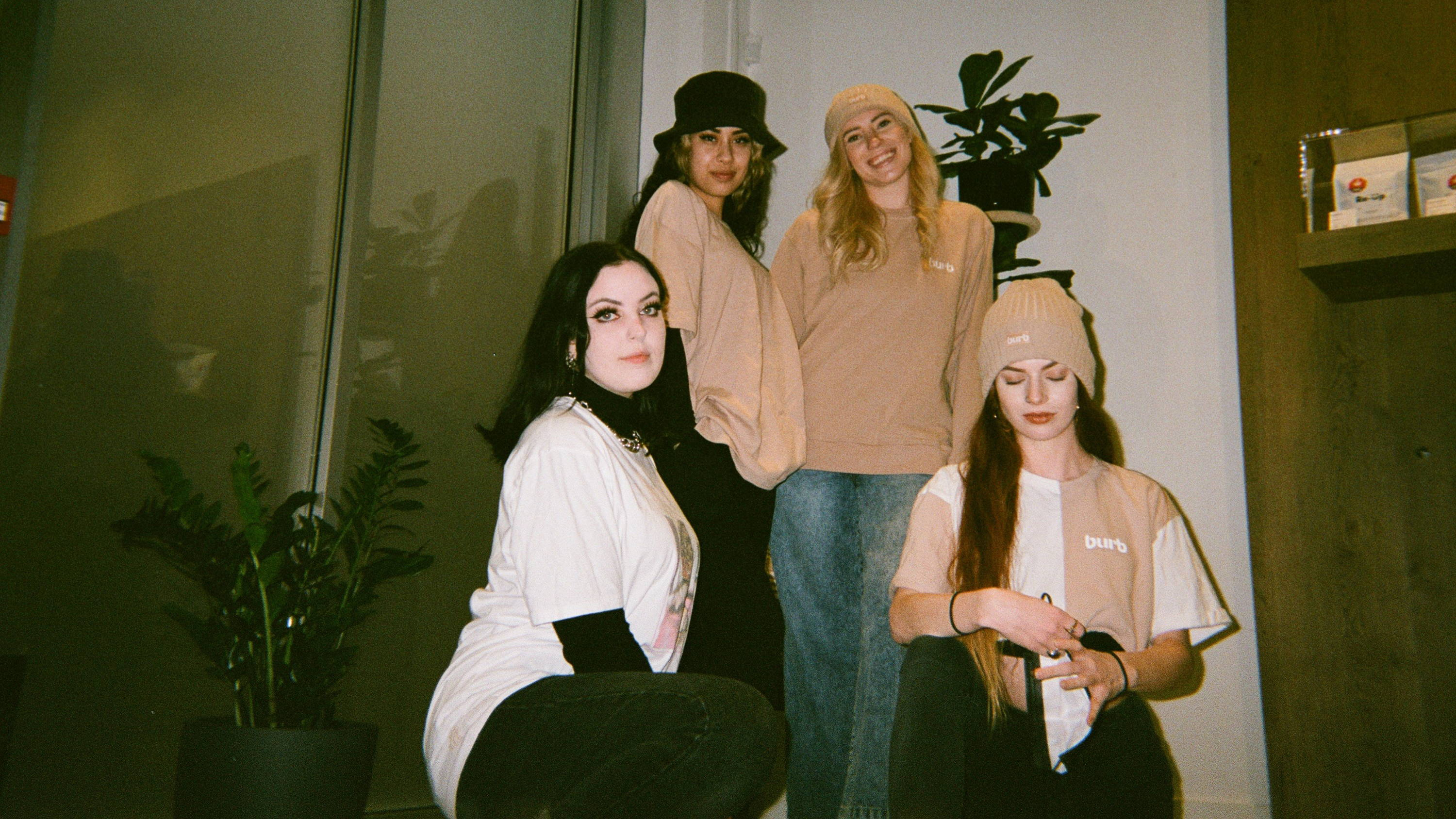 A photo of four women from Burb cannabis with the store behind them.
