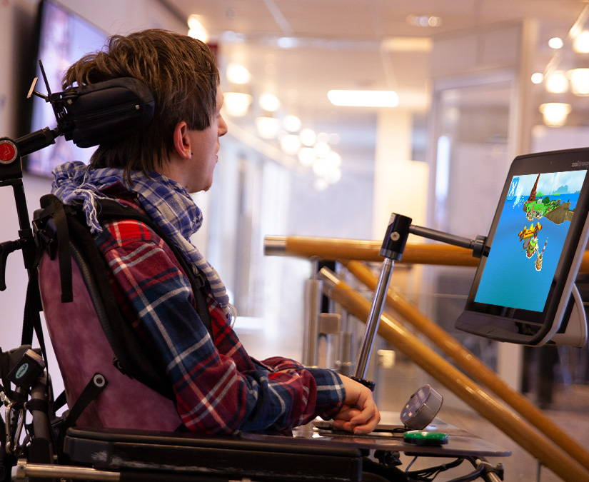 Victor Kaiser playing accessible games with his Tobii Dynavox eye gaze device