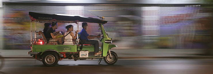 Ride a motorized 3-wheel vehicle known in Thailand as the tuk tuk