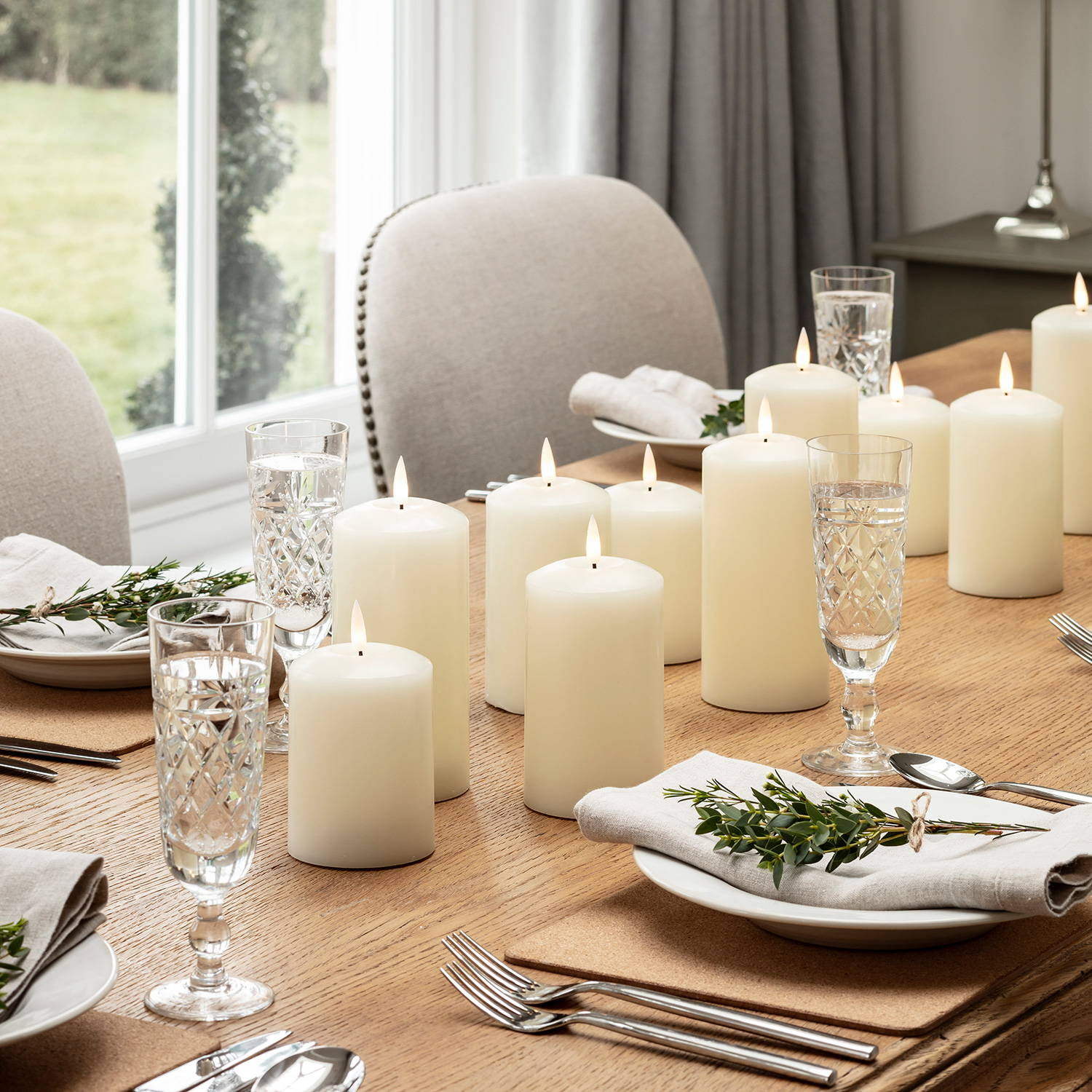 Assortment of ivory TruGlow candles  styled as table centrepiece