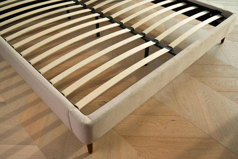 Bed frame with focus on slats and bed frame legs
