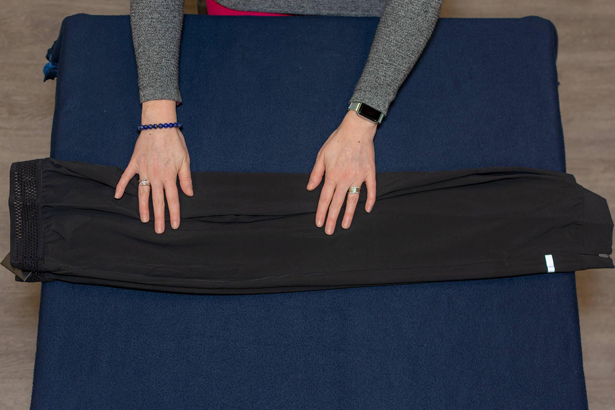 hands folding joggers