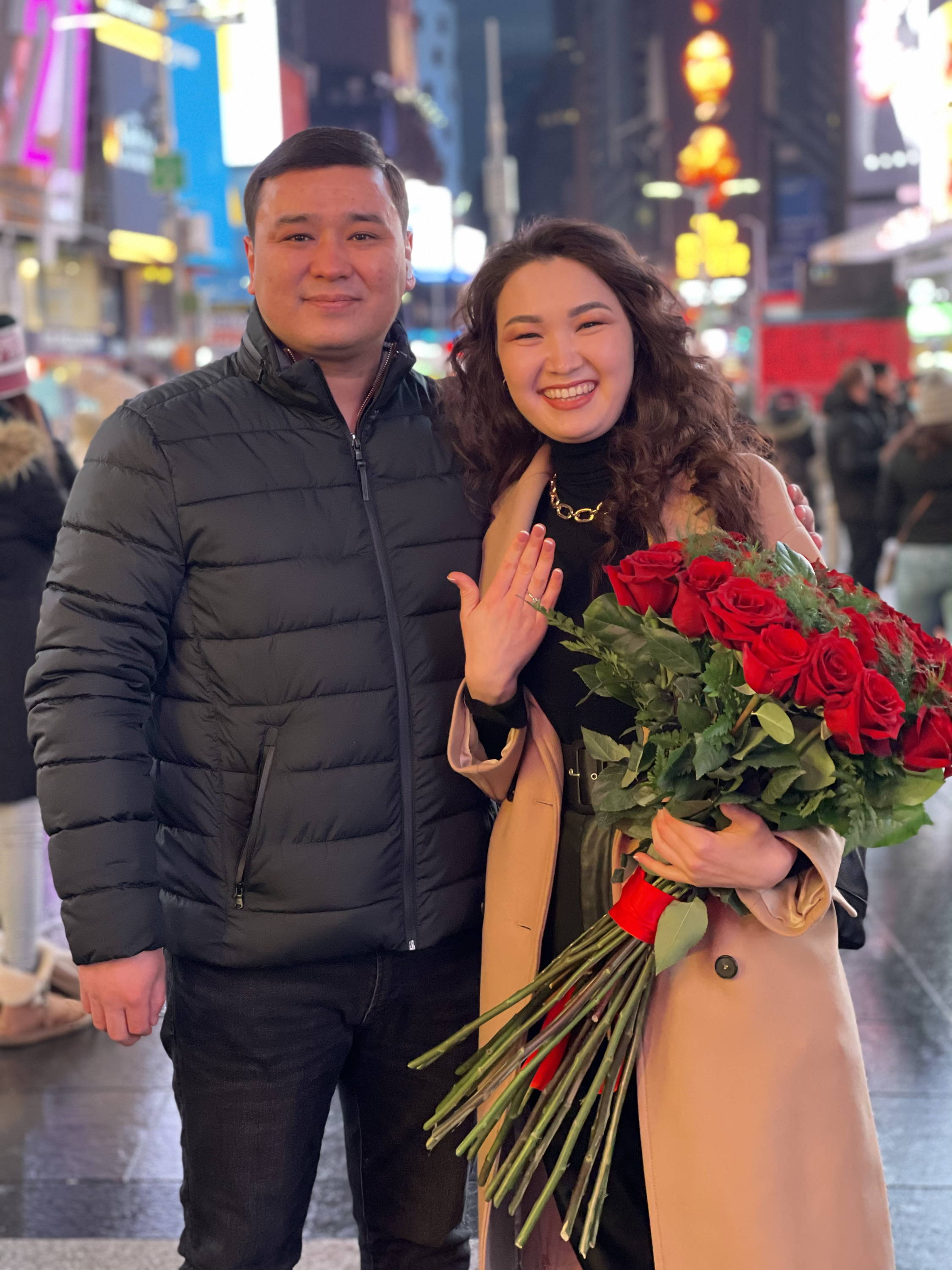 Henne Engagement Ring Couple Daniyar & Elmira Show Off Engagement Ring in Times Square