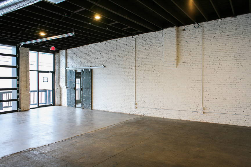 white brick walls and urban feel in event space and photography studio