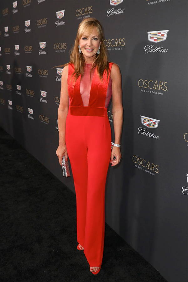 Allison Janney wears Galvan London Tulle Plunge Velvet Red Jumpsuit