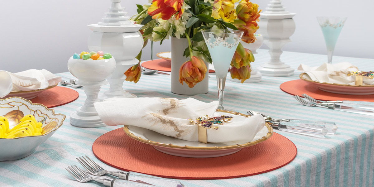 Easter table with turquoise stripes tablecloth
