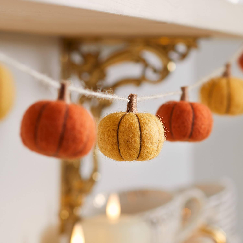 Felt pumpkin garland displayed across mantel