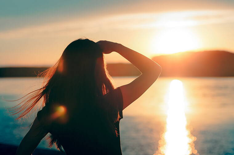 Woman Looking Into Sunshine