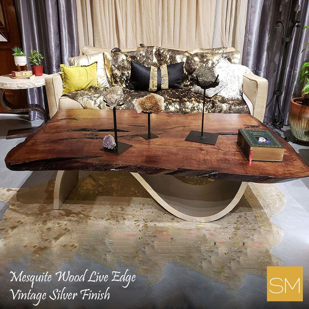 Mesquite wood live edge coffee table with a vintage silver finish base