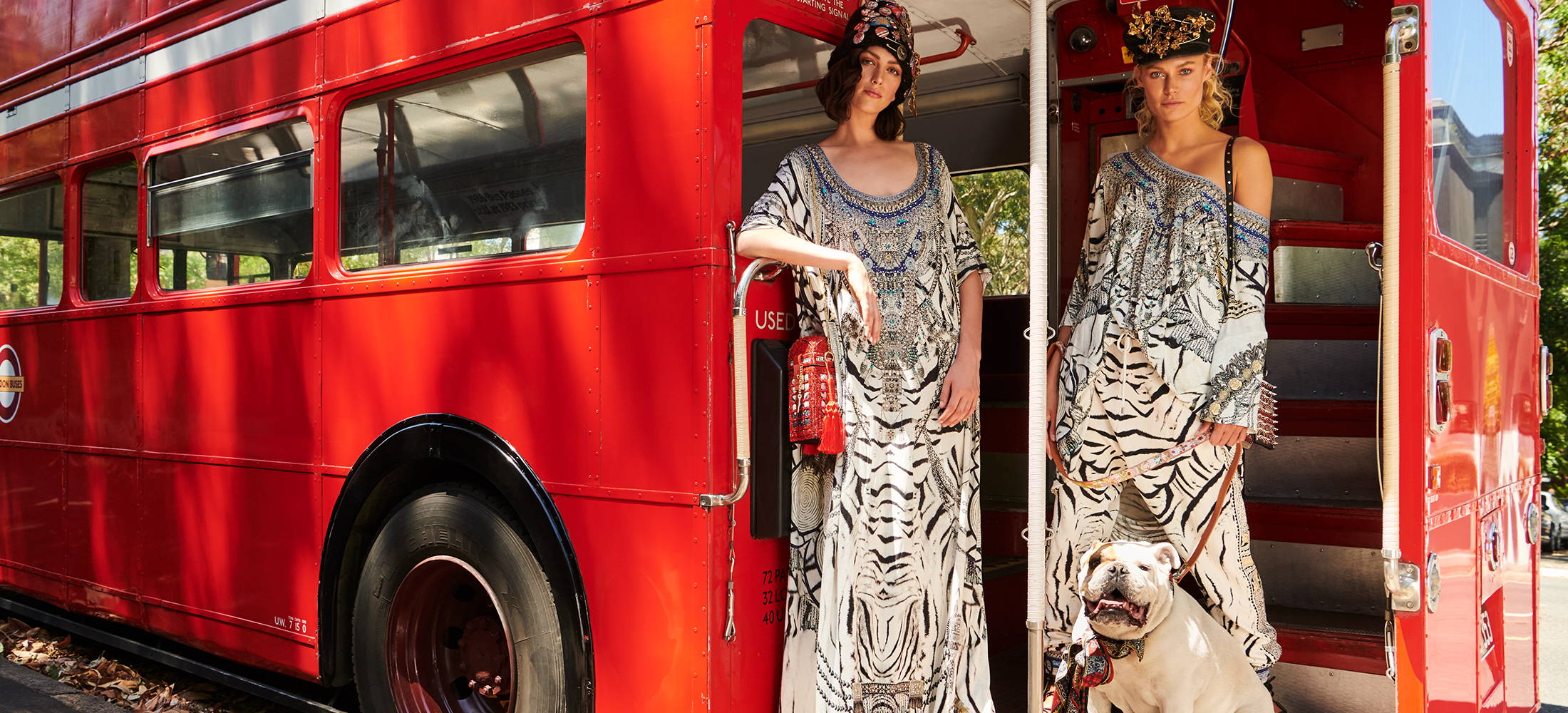 Models in Bus wearing CAMILLA round neck kaftan, tee and pants