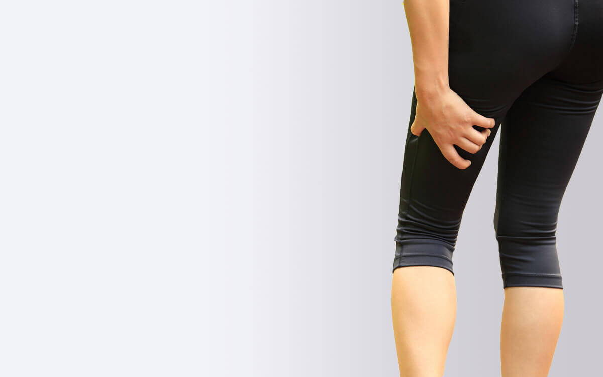 woman holding her leg sciatica