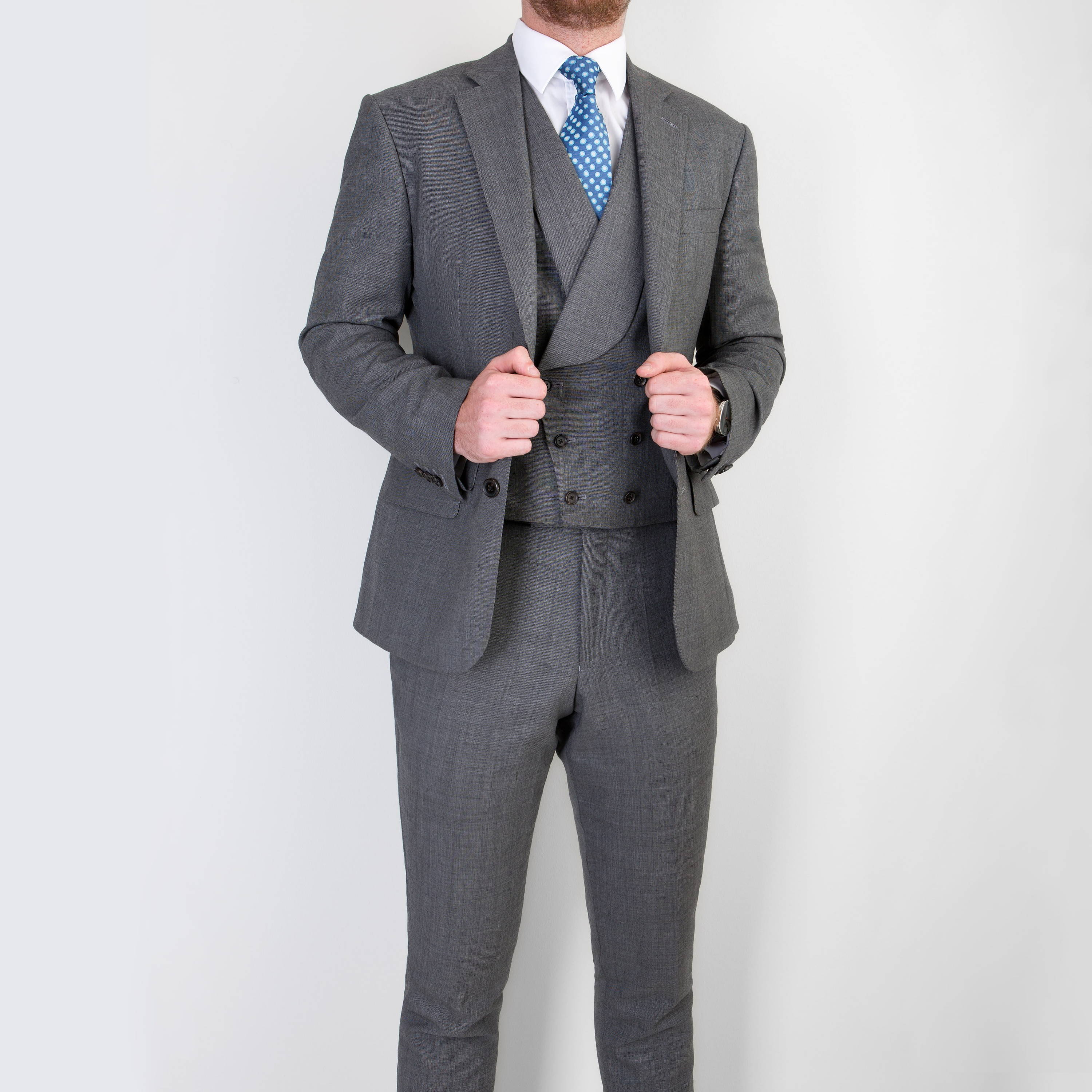 Three piece business suit being modelled by bespoke tailors Mullen and Mullen