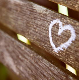 white-heart-on-wood-bench-selfless