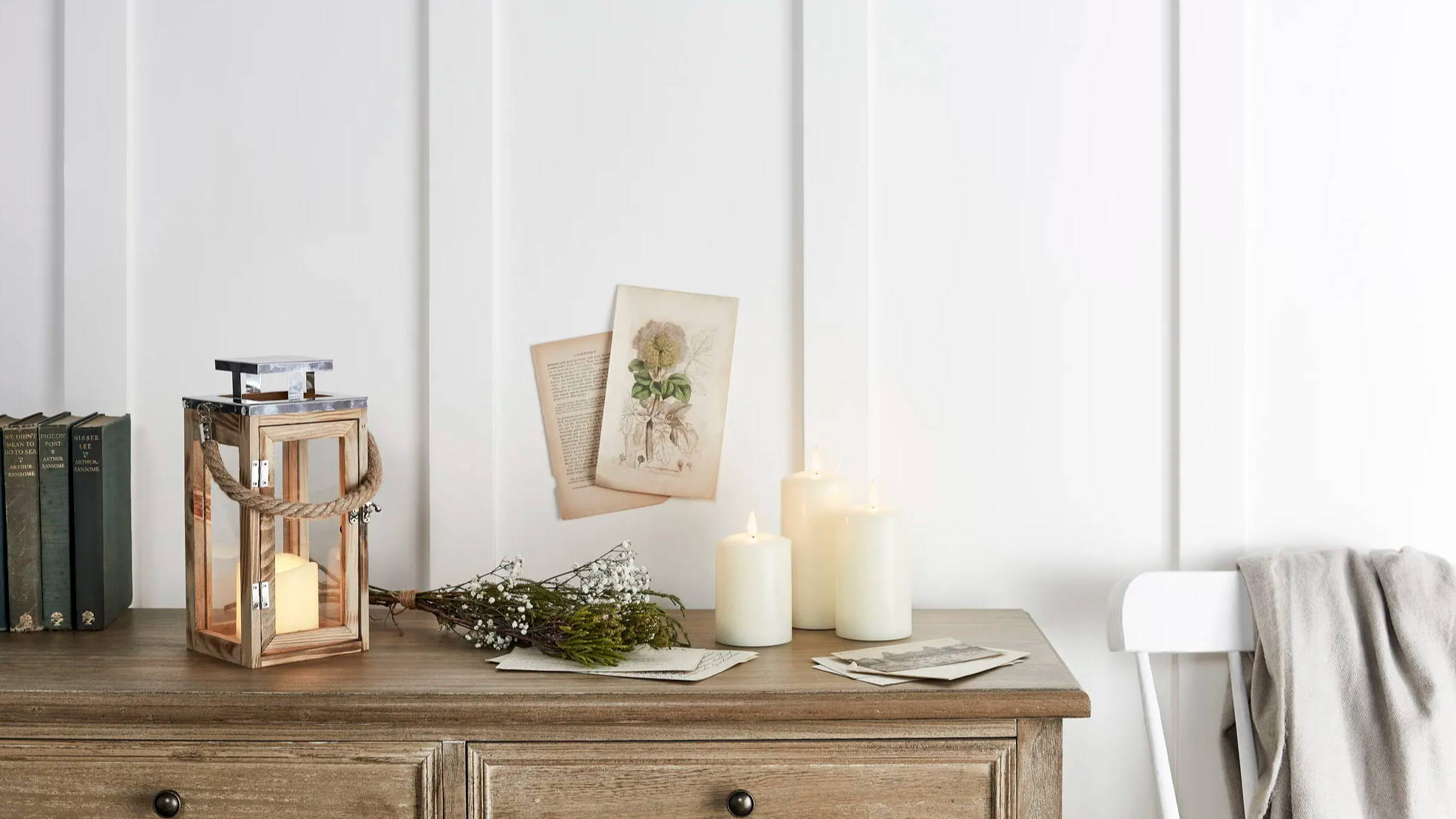 Salcombe wooden lantern and TruGlow flameless candles on side table with spring foliage