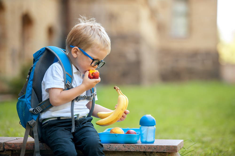 Boy eating fruit