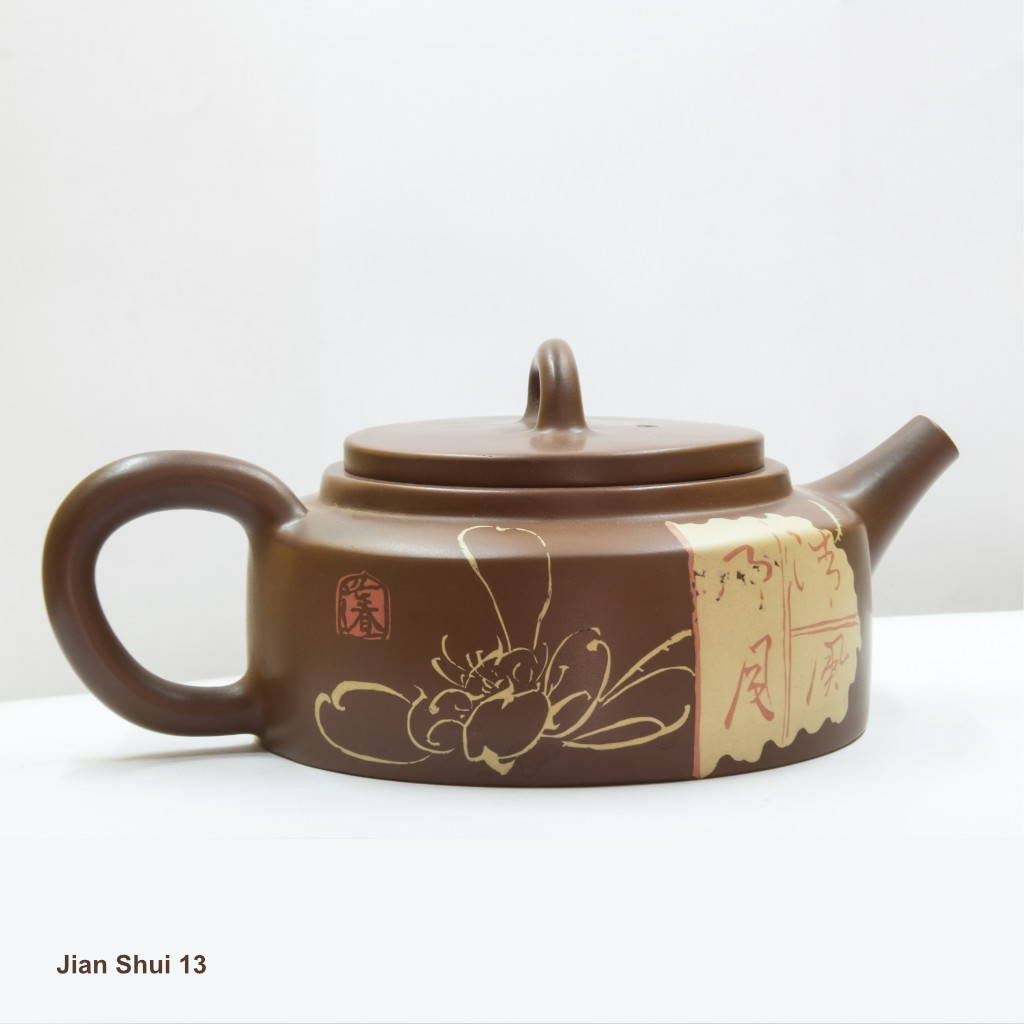 Jian Shui Teapot with inlaid clay design