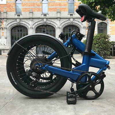 A folded full-sized folding electric bicycle.
