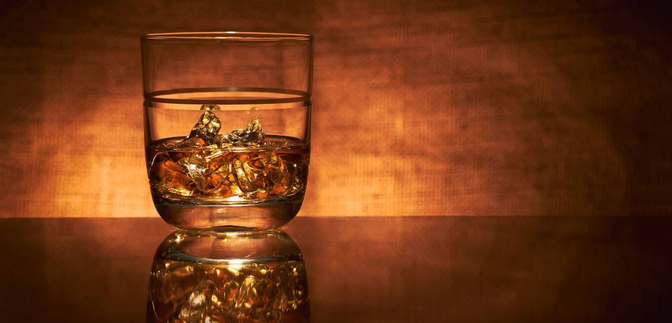 A glass of malt whisky and ice