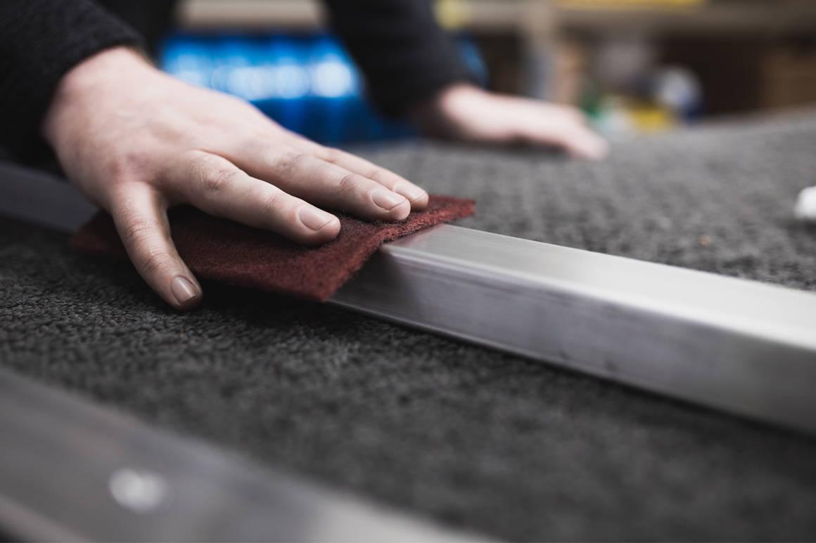 use scotch-brite pad to brush bare aluminum posts and handrail