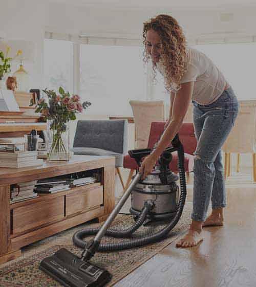 majestic woman vacuuming