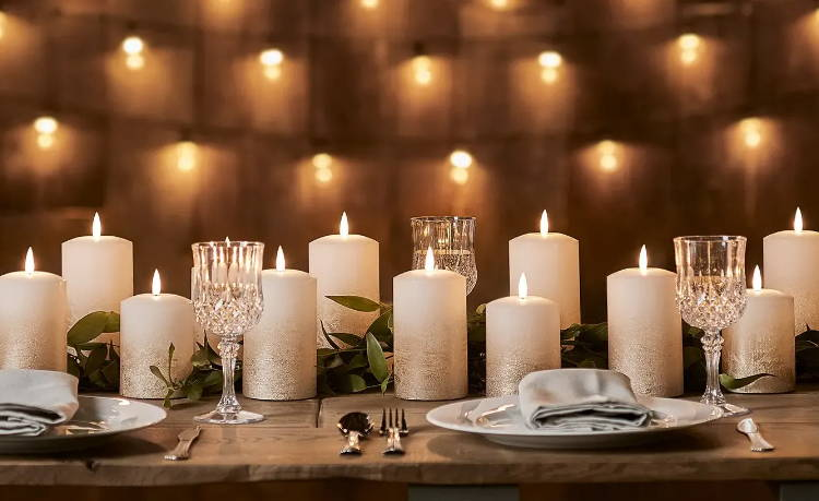 bronze ombre TruGlow led pillar candles placed along a set table