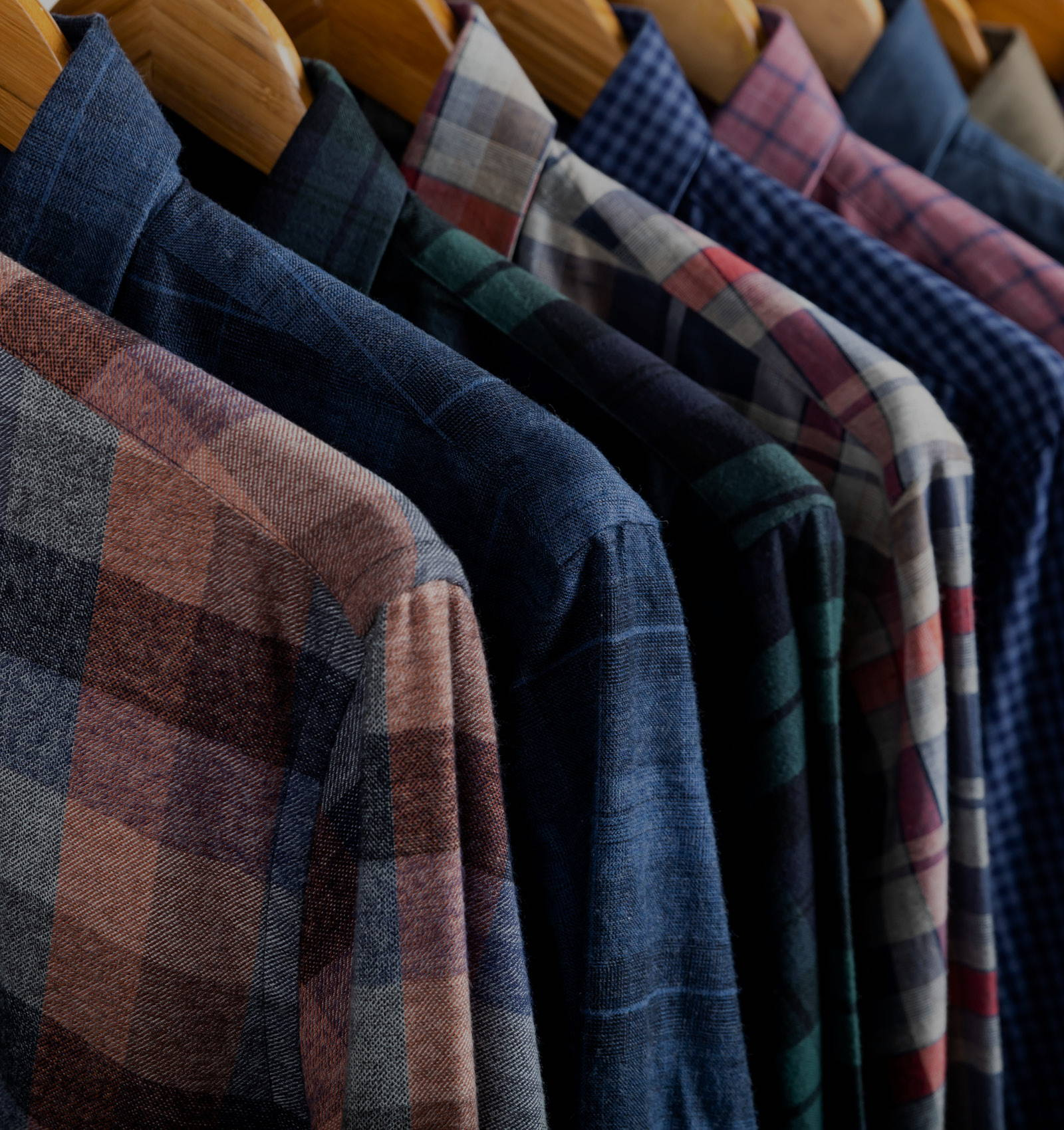 Close up of casual shirts on hangers.