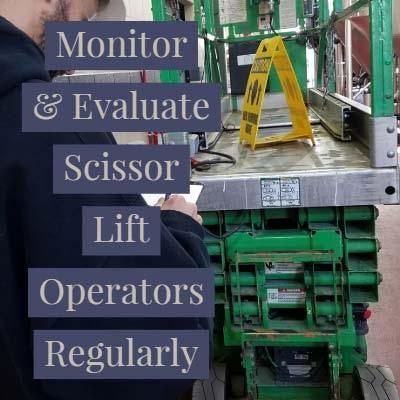 A Supervisor Evaluates A Scissor Lift Operator