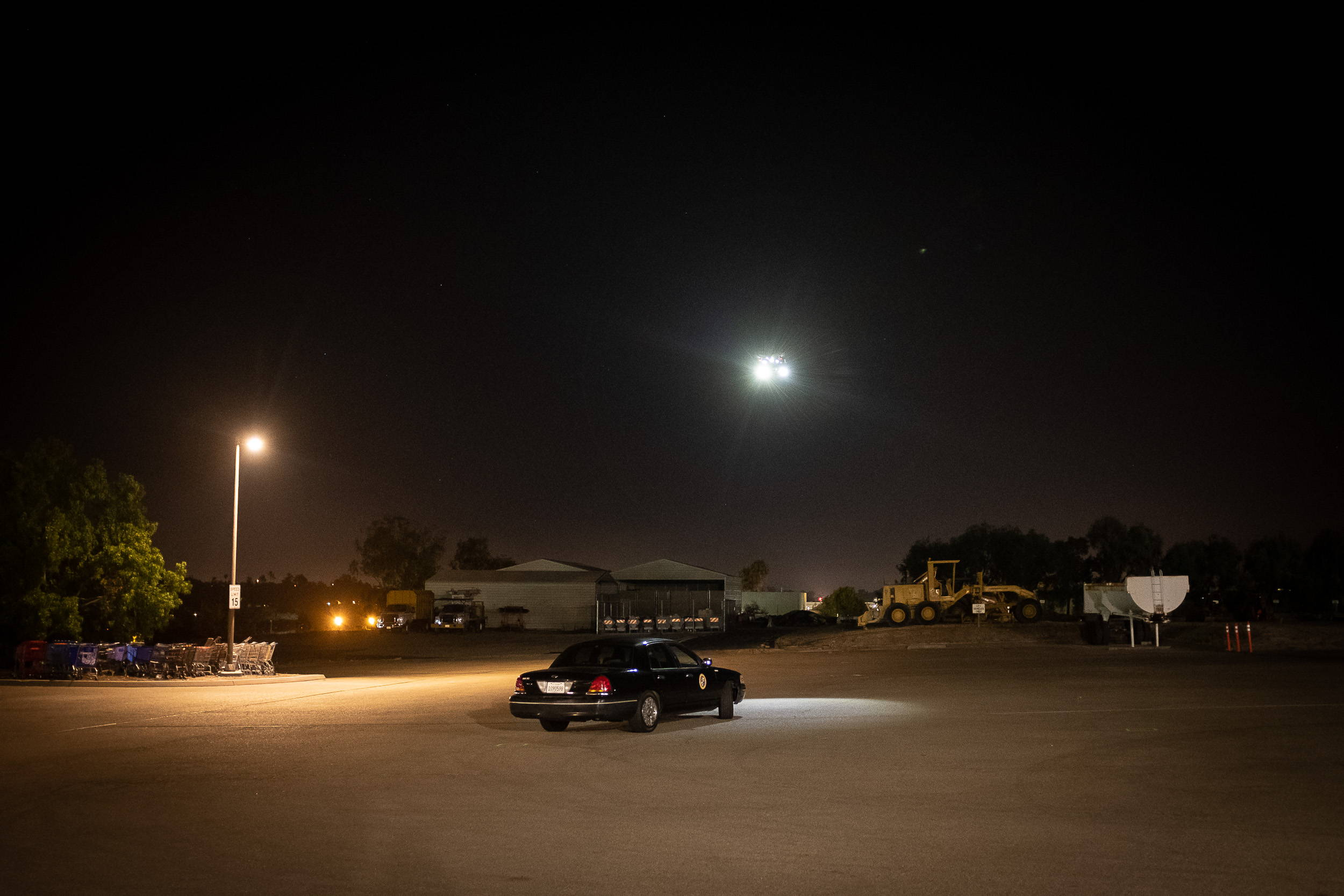 A Matrice 200 with two FoxFury Rugo lights assess a hostage situation with a vehicle.