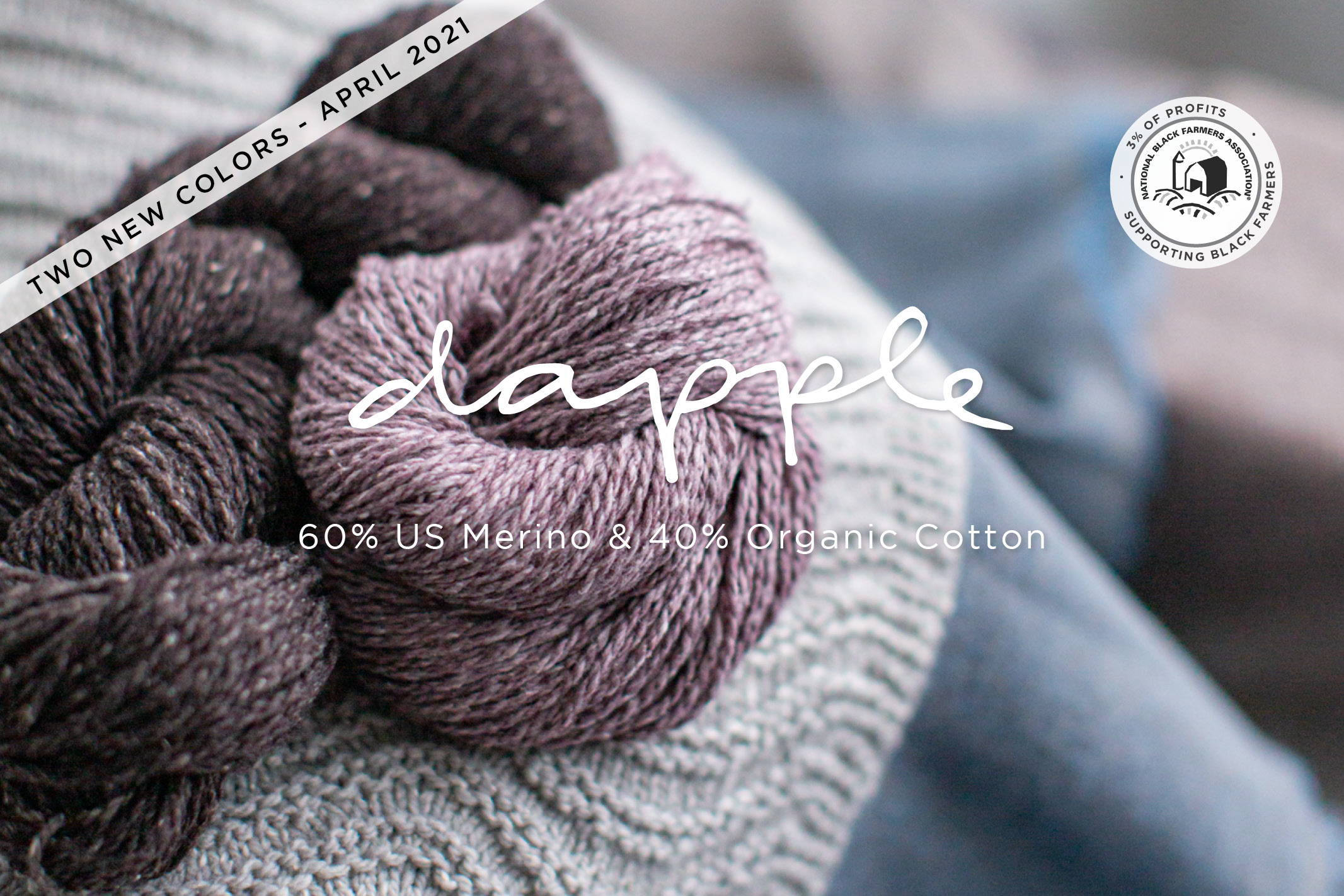 Dapple Yarn balls on table sitting on knitted fabric | 60% US Merino & 40% Organic Cotton