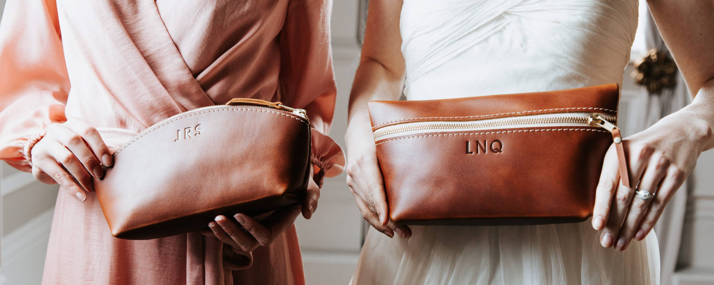 bride and bridesmaid holding personalized makeup bags