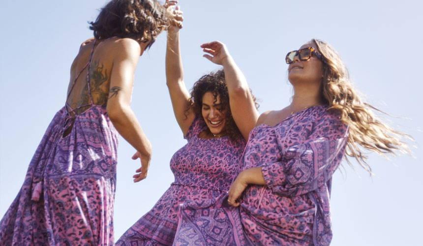 Spell Sisters Facebook Group image of 3 girls dancing in purple printed garments