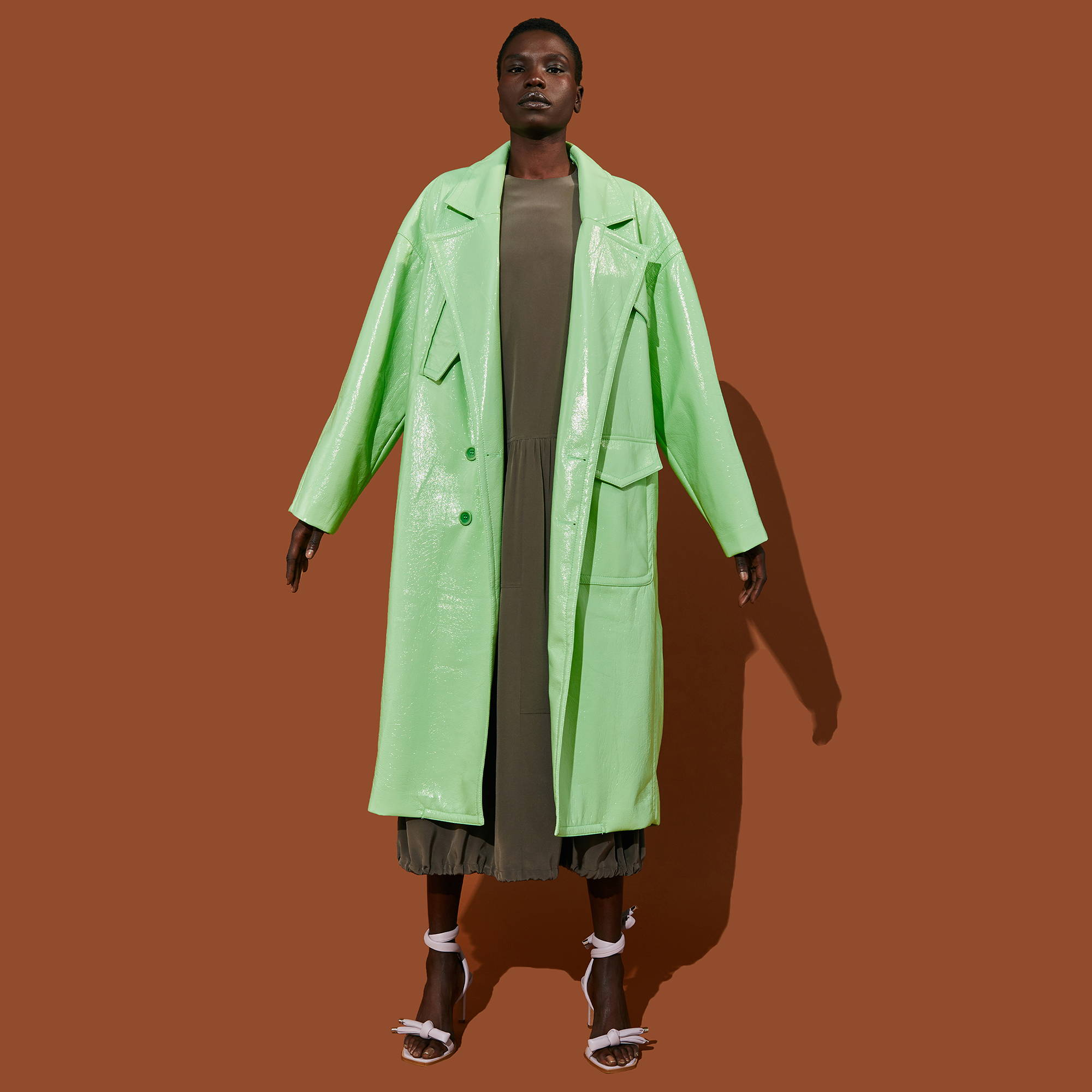 One model wears long green coat