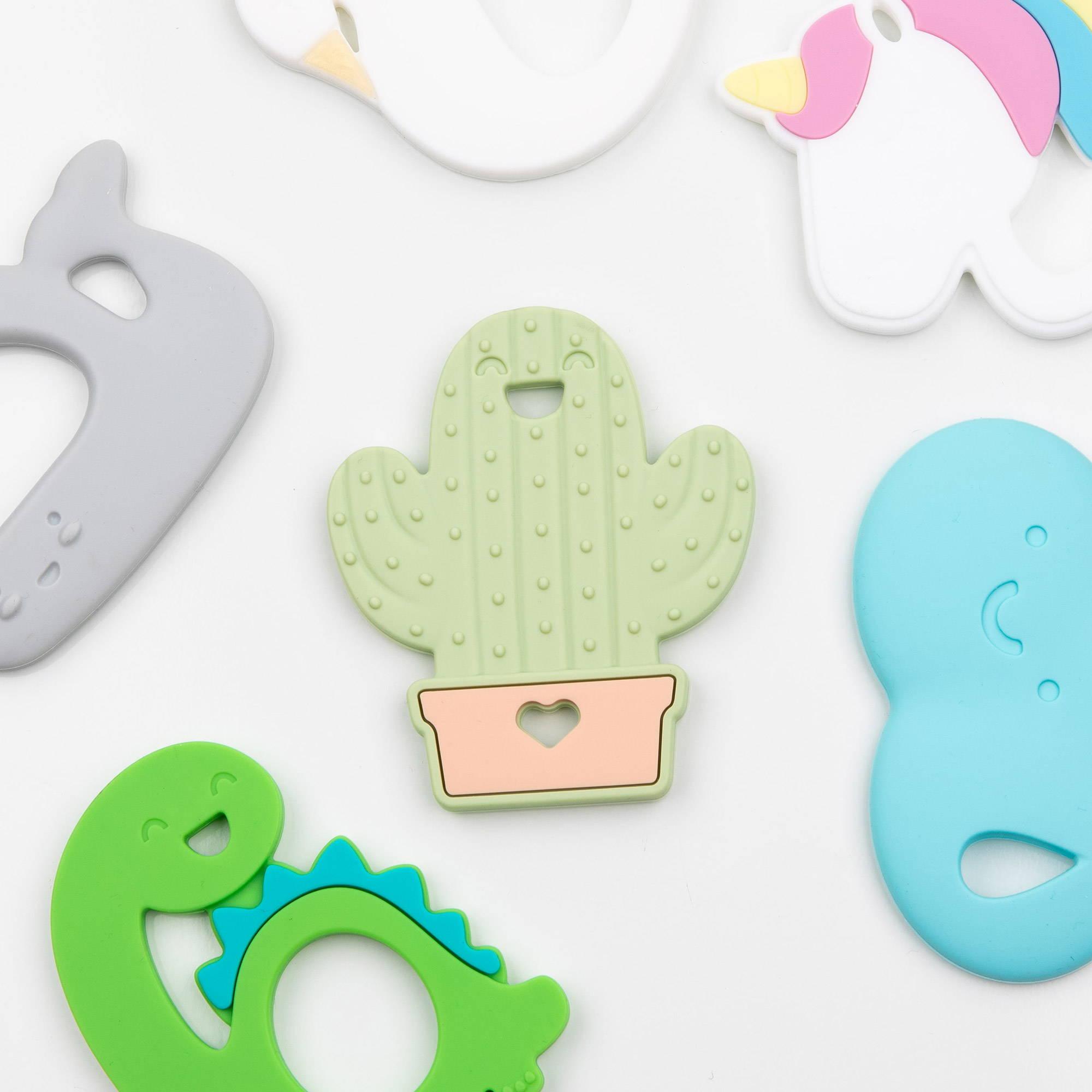 cactus, dinosaur, unicorn, swan, whale, and cloud baby teether