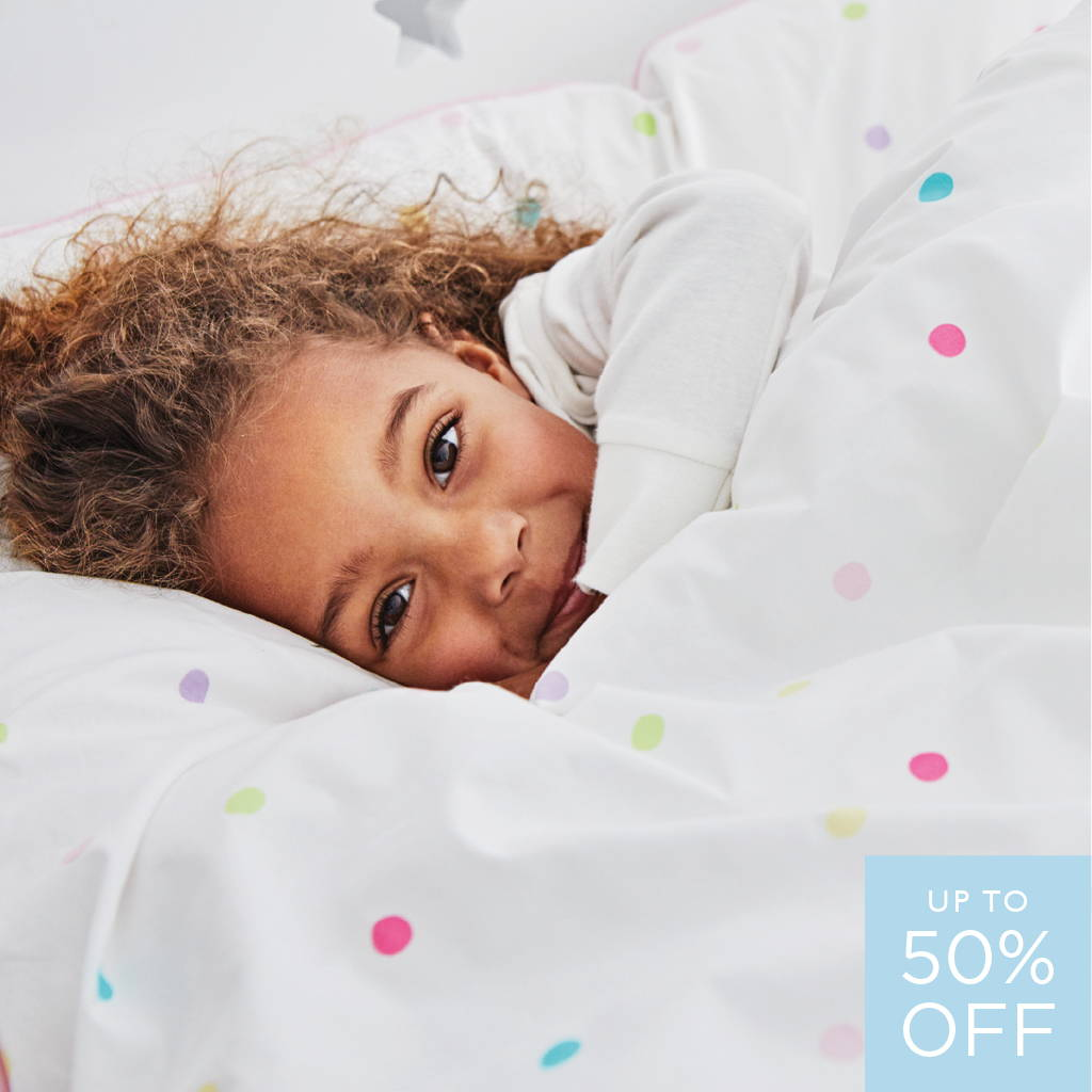 Young girl sleeping in duvet covers