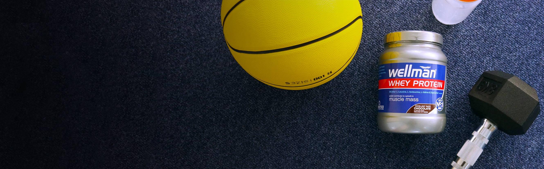 Whey Potein Bottle Next To Basketball