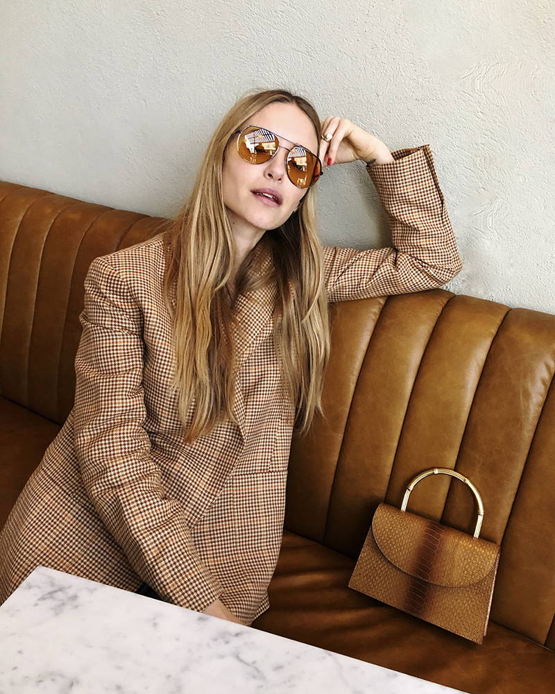 Pernille Teisbaek with the Oroton Grace Top Handle Clutch and Oroton Cotton-Linen Houndstooth Blazer