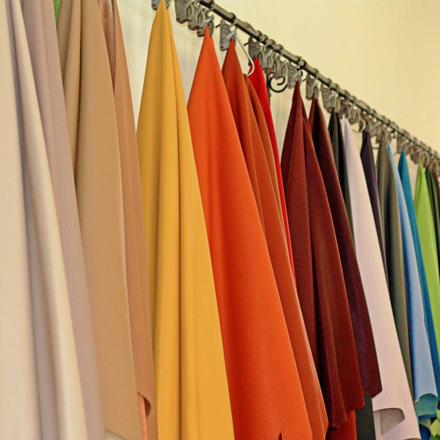 coloured leather hides hanging in factory