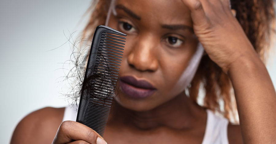 shocked woman suffering hair loss