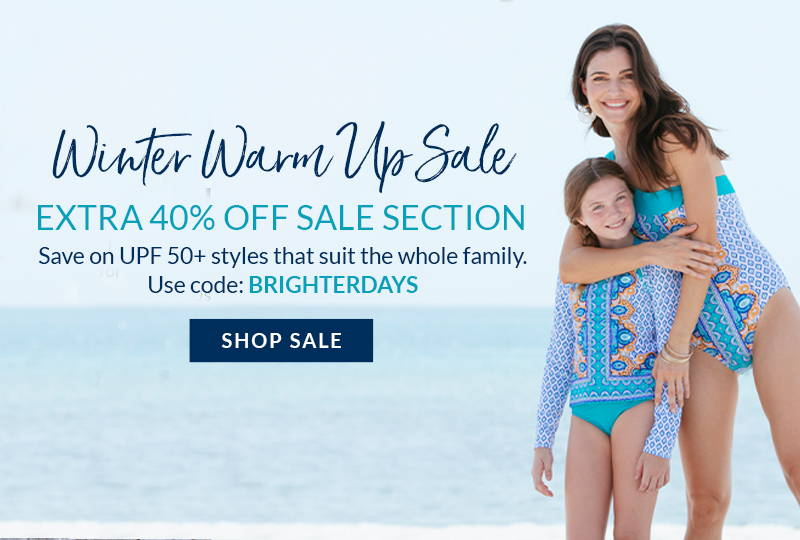 Winter Warm Up Sale: Extra 40% off sale section with code BRIGHTERDAYS. Woman wearing Jewel Scarf One Shoulder One-Piece