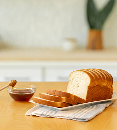 TRY OUR NEW HONEY WHEAT SLICED BREAD