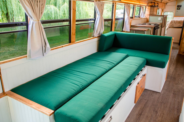 Awe Inspiring Green School Bus Converted Into Cabin On Wheels Theyellowbook Wood Chair Design Ideas Theyellowbookinfo