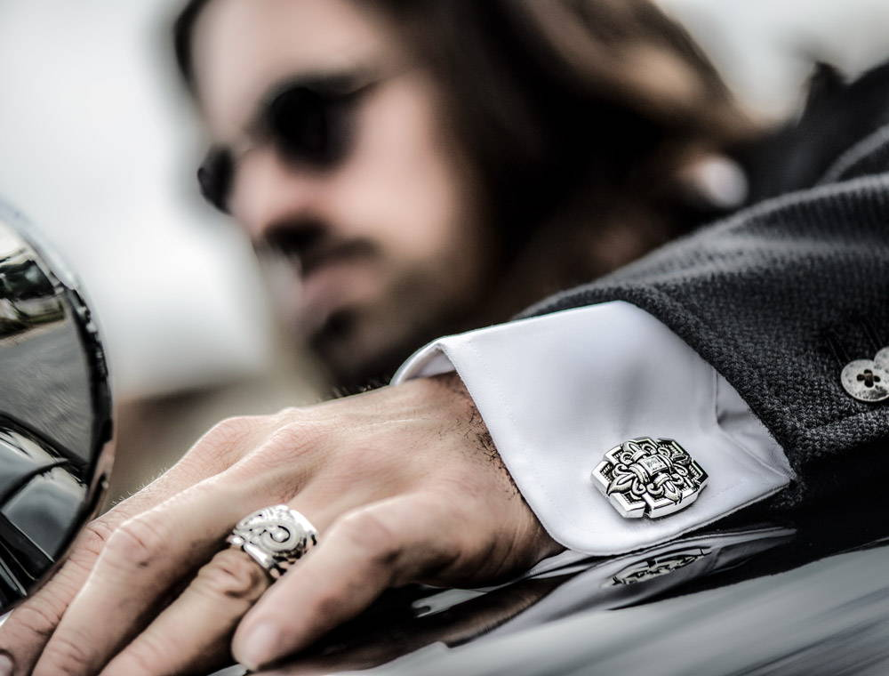 Man Driving While Wearing Sanctified Cufflinks and Aeonian Ring by NightRider Jewelry