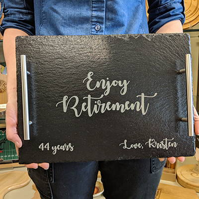 An engraved slate tray used for a retirement gift.