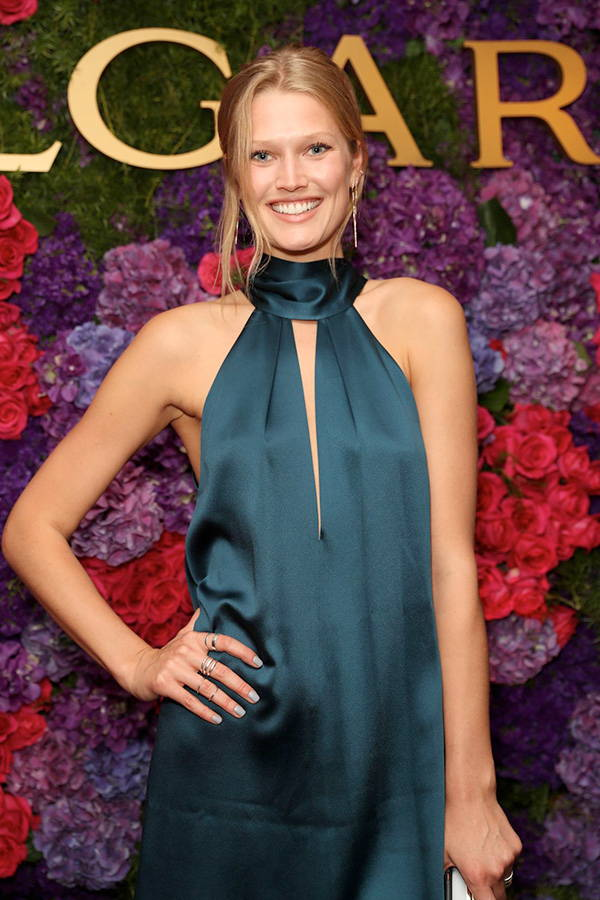 Toni Garrn wears Galvan London High Neck Mini Satin Emerald Dress
