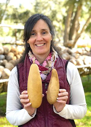 Phoebe holding 2-2.9 inch diameter People Gourds, 6-11 inches tall