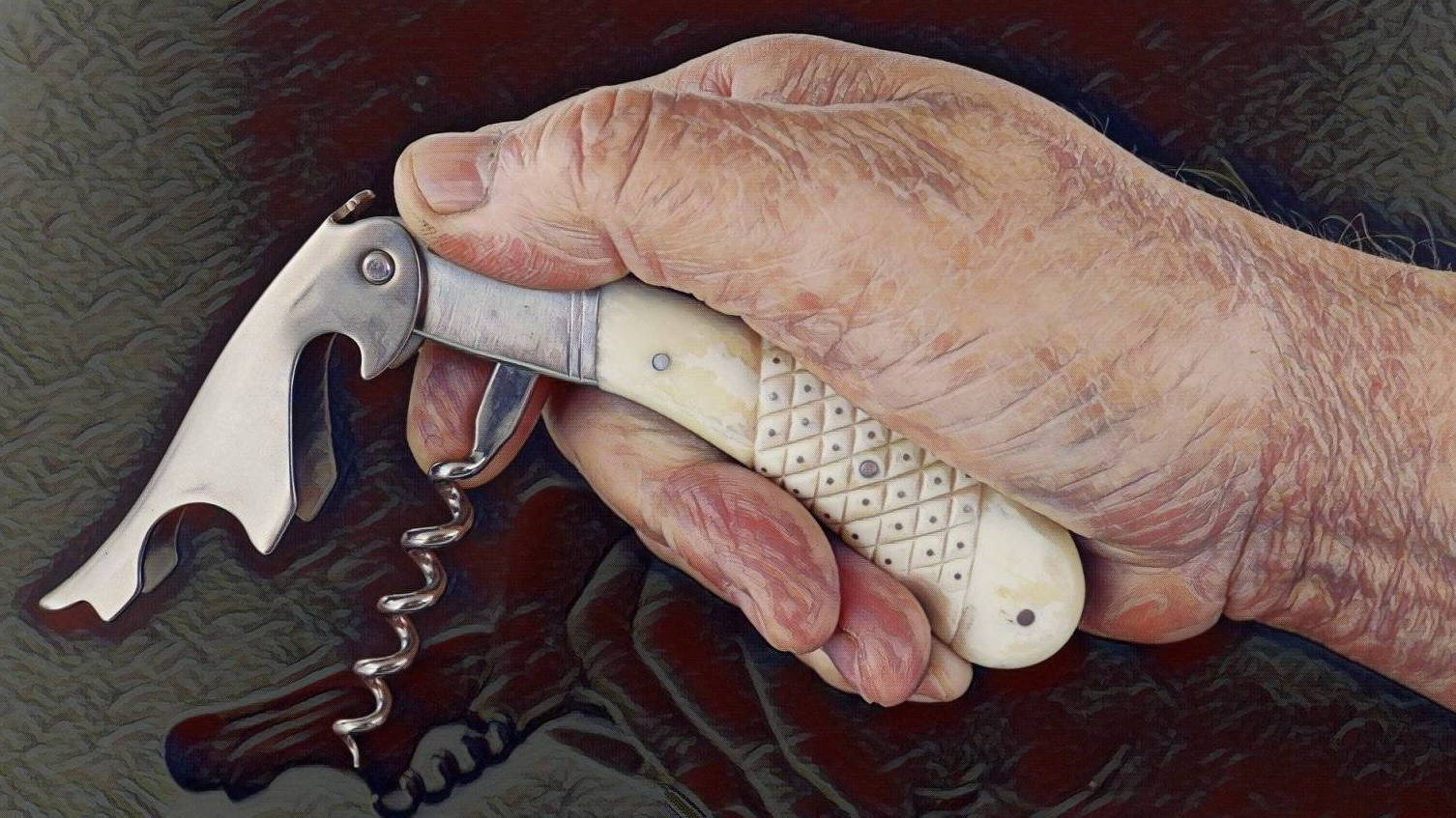 MAGNUM corkscrew shown in an adult man's hand for size perseption.